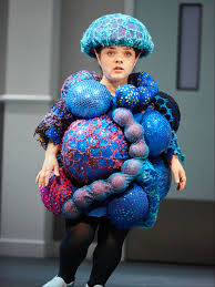 Actor dressed as cancer cells